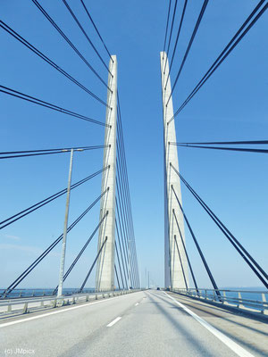 The girder of the Oresund Bridge rise up into the blue sky impressivly