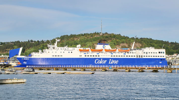First ferry: Color Line's ferry MV Bohus in the port of Sandefjord (evening sunlight).