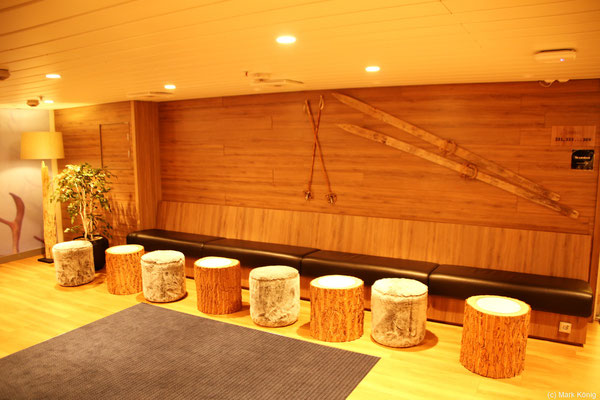 Trendy and warm in nordic design: the waiting bench at the reception of the ship