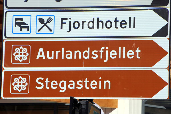 Street signs in village Aurland guide the way