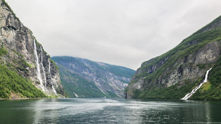 Geirangerfjord with waterfalls Seven Sisters on the left (north) side and Friaren on the right (south) side