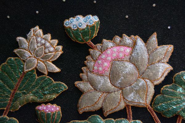 Kunstvolle Perlenstickereien