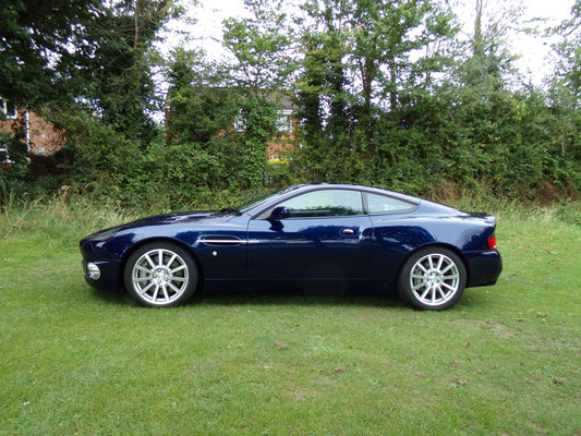 Side view of finished body repair work carried out by Precision Paint on a blue Aston Martin Vanquish S