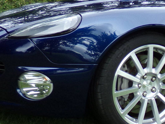 Close up of full body work by Precision Paint on a blue Aston Martin Vanquish S