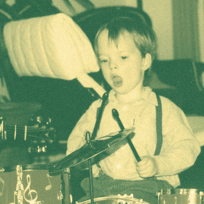 This picture shows me playing the drums at the tender age of 3. So yeah, music was there from the beginning.