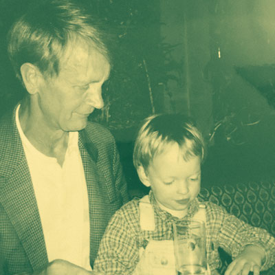 Me and my grandpa spending some quality time together. I guess we were playing with my set of wooden trains.