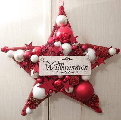 """Stern in rot und weiß mit """"Willkommensschild"""" für den Eingangsbereich."""