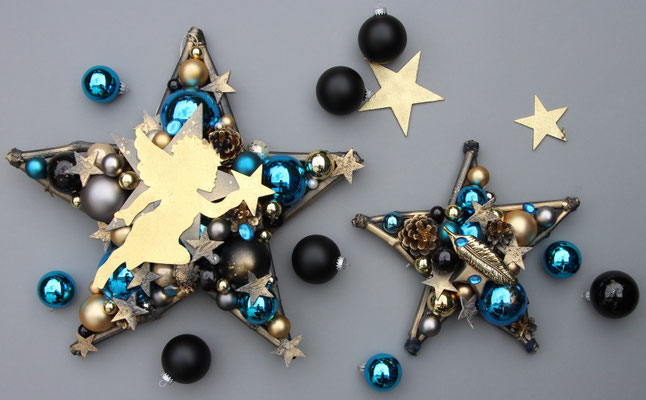 Zwei Deko Sterne auf grauem Untergrund in Gold und Blau, eine edle Kombination.