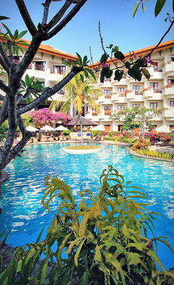 Garden and swimming pool at the Grand Mirage Resort in Bali | Hotels In Bali Indonesia | via @Just1WayTicket