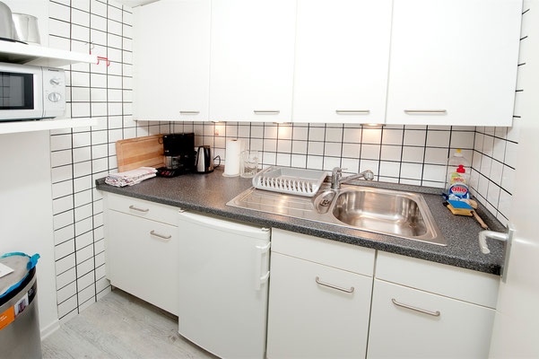 Kitchen with refridgerator, microwave oven and percolator