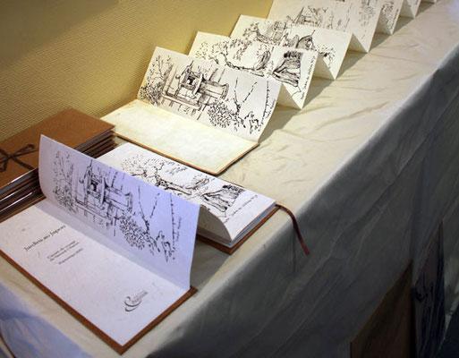 Livre et carnet d'origine dépliés