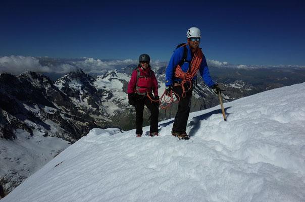 Glückliche Gesichter auf dem Jungfrau-Gipfel.