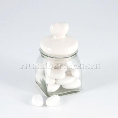 Barattolo in vetro con tappo ermetico in ceramica bianca, capacità 120 ml < cm.5,5x5,5 h9  € 2,30