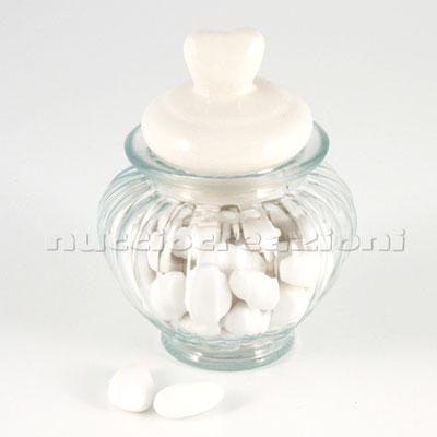 Barattolo in vetro con tappo ermetico in ceramica bianca, capacità 300 ml < cm.10x10 h12 €3,00