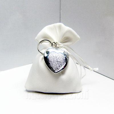 sacchetto stoffa panna con portachiavi argentato € 5,00