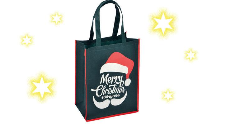 Weihnachtstragetaschen Non Woven in grün mit roter Umrandung Nikolausmütze und weißem Schriftzug Merry Christmas Frohe Weihnachten allen stabile Weihnachtsbeutel