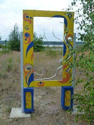 Den Übergang zum Sedlitzer See bildet eine Skulpturengruppe