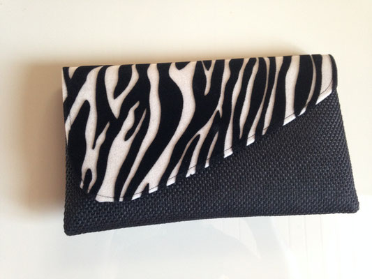 13. bag, 27 cm  x 16 cm, black, cover with zebra style, 30,- CHF