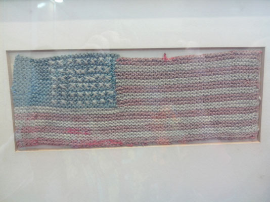 The flag made by Fench women for the first burial of Sgt. Charles R. Perry in August 1944 - 2014