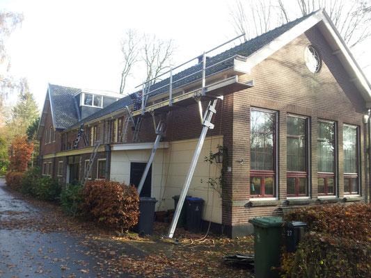 Aanbrengen nieuwe dakgoten project Brink