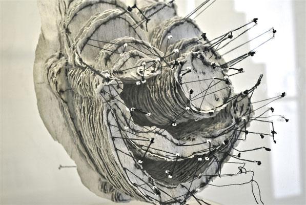 Masks (detail), Printed papers, thread, plexiglass, 18.5 x 14 x 10 in, 2014