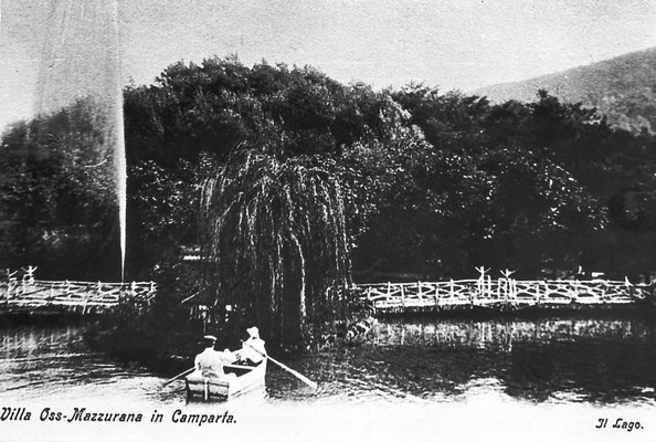 Villa Oss Mazzurana, il lago artificiale, al  centro vi era un isolotto. in cima alla collina vi era una centrale elettrica. Da Archivio Scuola Elementare  di Vigo Meano