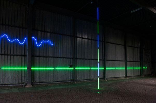 "Jan van Munster, ""Brainwave (Ratio)"", 2016, Blue and green glass, argon, transformers, varying dimensions. Noletloodsen Schiedam (NLD) exhibition: Snapshot of a Larger Order (de Ketelfactory), 2016 ,Foto: Guus Rijven"