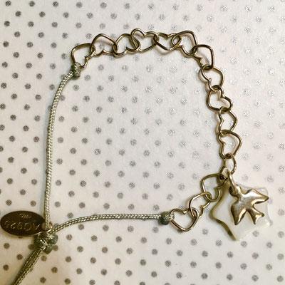 Chaîne de coeurs en argent 925 montée en bracelet sur fil de jade et noeud coulissant 13€ l'unité