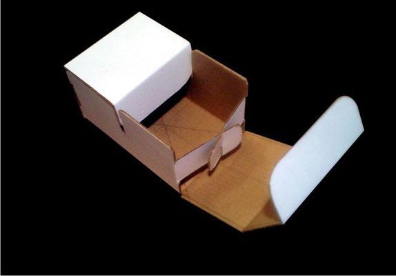 1.- Caja de doble compartimiento.