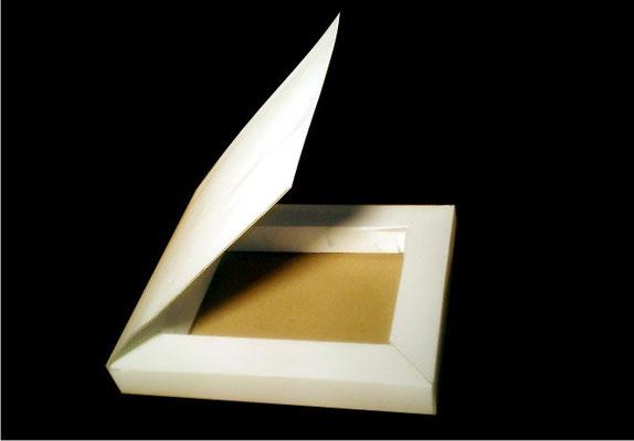 19.- Caja tipo libro.