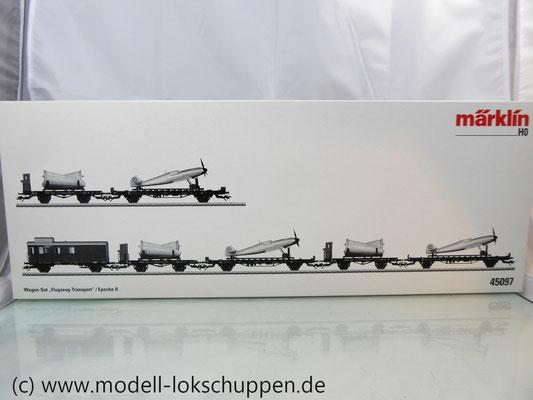 Märklin 45097 Wagen-Set - 6 Flachwagen und 1 Güterzug-BegleitwagenDRG Flugzeug-Transport Me 109    1