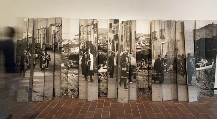 Mémorial Retirada 3, images photographiques laser marouflées sur planches de bois brut, 200x500x40cm. Musée Mémorial de l'Exil, La Jonquera, Catalogne-Espagne, 2013.