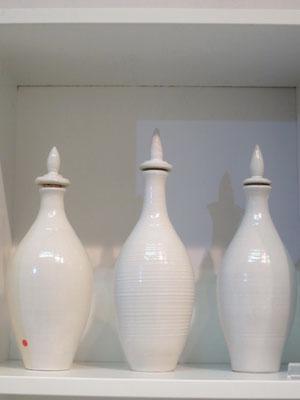 Drei Flaschen für Olivenöl