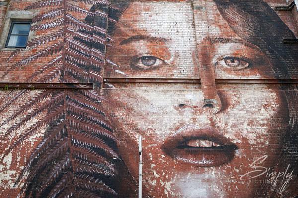 Christchurch, Portraitgrafiti auf einer Hauswand