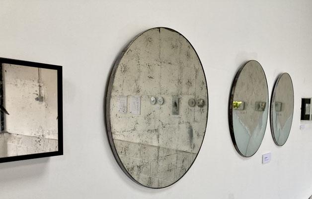 engraved water gilded palladium leaf mirrors.   40cms dia