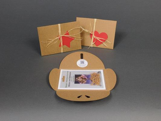 Geschenkkarton geöffnet, im Hintergrund sind Geschenkkarton mit einem Herz oder Stern Symbol
