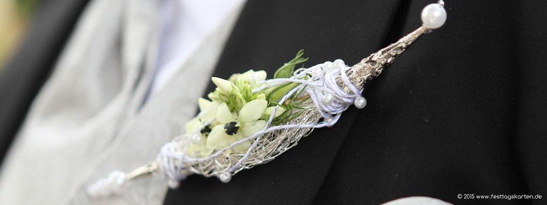 Der Reverschmuck für den Bräutigam, zur Brautspindel gehörig