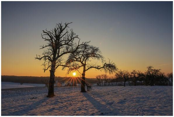 Untergehende Sonne zwischen Raithaslach und Mahlspüren i. Hg. 5644