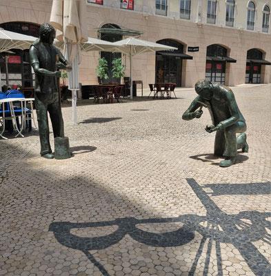 Skulptur zu Ehren der Pflästerer.