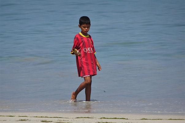 ...und schauen dem Junge beim fischen zu.