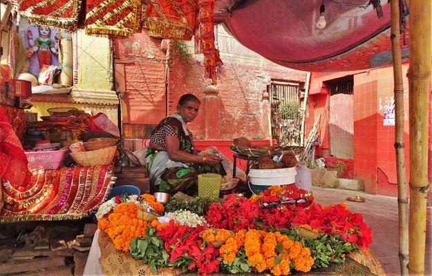 ...Blumenverkäuferin.