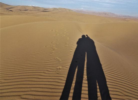 Unser Schatten auf dem Sand.