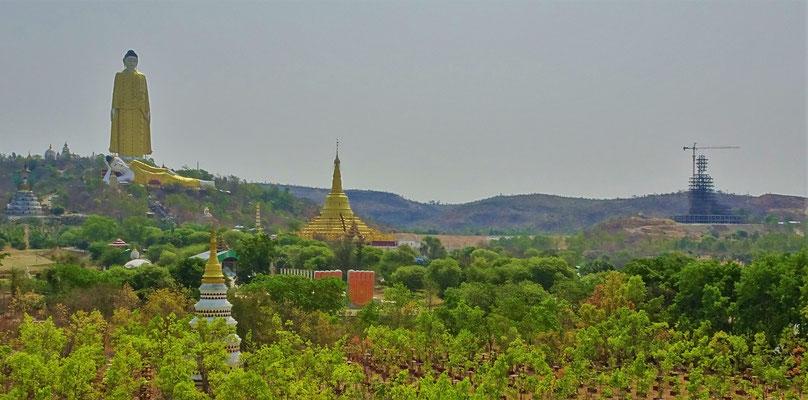 ....den Hügel mit dem stehenden und liegenden Buddha.
