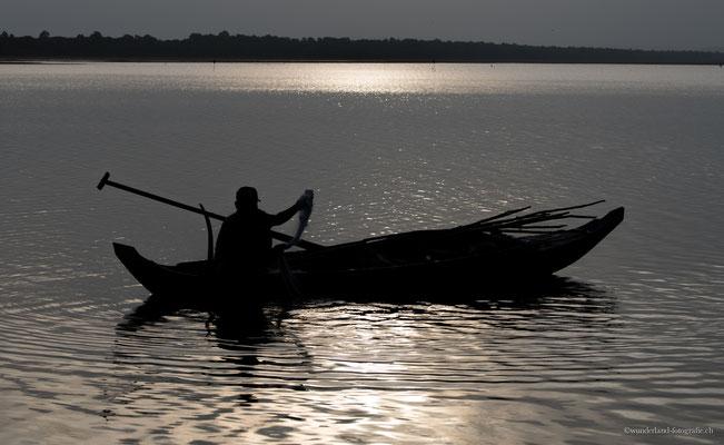 Fischer beim Sonnenaufgang