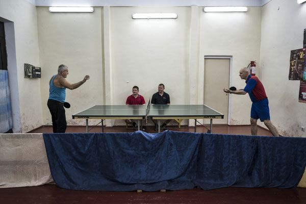 A game of ping pong at the gym of Chernobyl. Many workers come here to exercice after their shift in order to keep fit