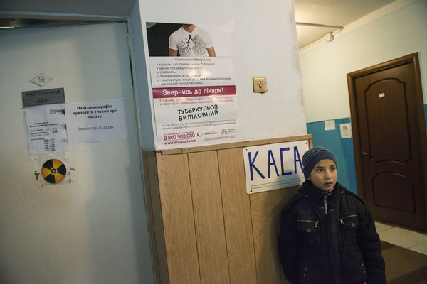 A child while waiting to be visited for internal contamination at the Ivankiv hospital. Ivankiv.
