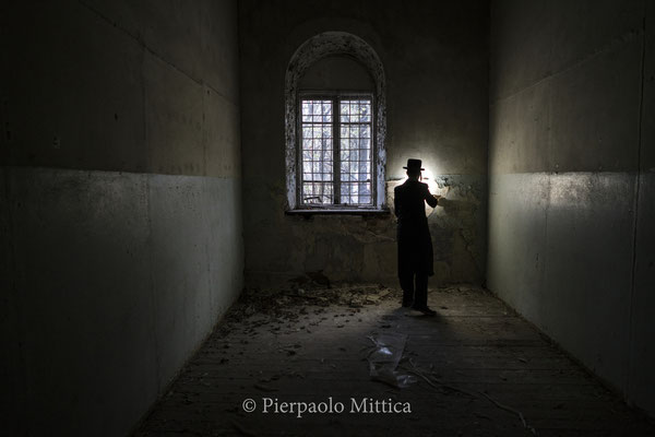 A Jew inside the Chernobyl synagogue. Chernobyl had 5 synagogue, which were destroyed during the pogroms and communism period. Only one is still standing today and under the Soviet period became a military recruitment center.