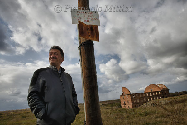 Gilani Dumbaev in the evacuated and contaminated village of Muslyumovo where he lives. The signs warn: exclusion zone, forbidden to enter. He comes from Chechnya and lives for 20 years in old Muslyumovo, on the banks of the Techa River.