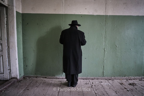 Yitz Twersky while praying inside the abandoned Chernobyl Synagogue. On 2017 he did his first trip to Chernobyl to visit the grave of his ancestor and the sacred places for Hassidic Jews.