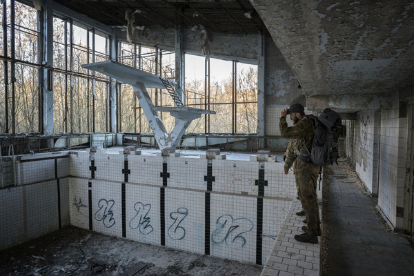 Jimmy in the abandoned pool of the ghost town of Pripyat. Stalkers spend their days exploring abandoned buildings, reading old USSR magazines or books they find, hiding and escaping police and living as they were the last survivors of the planet
